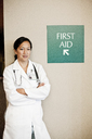 Asian woman doctor in lab coat with stethoscope. - MINF08276