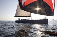A crew races a modern ocean-going sailing yacht under spinnaker. - AURF00130
