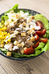 Bowl of Caesar salad with meat, corn and tomatoes - GIOF04127