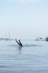 Man doing handstand in water, falling down - AFVF01394