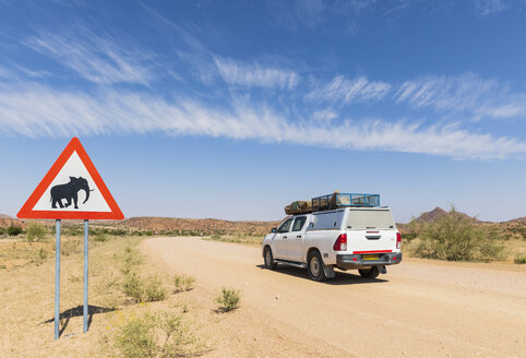 Namibia, Erongo Region, off-road vehicle on sand track, deer crossing sign with elephant - FOF10034