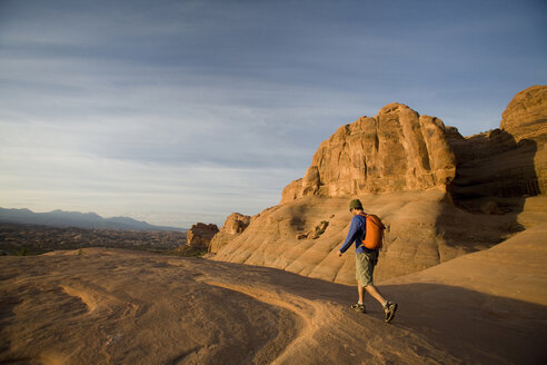 Young man hiking in Arches National Park near Moab, Utah. - AURF00270