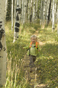 Young girl hiking the Engineer Trail in the fall, San Juan National Forest, Durango, Colorado. - AURF00273