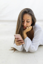 Portrait of young woman looking at cell phone - AFVF01418