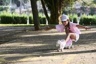 Little girl skating and doing tricks - IGGF00512