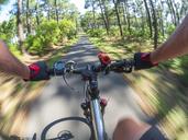 France, Landes, senior man on e-bike in the forest - LAF02074