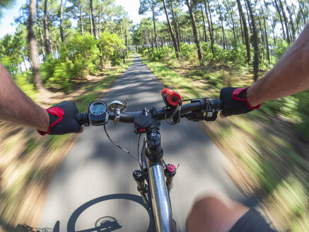 France, Landes, senior man on e-bike in the forest - LAF02074