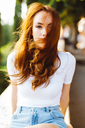 Portrait of redheaded woman with blowing hair - GIOF04213