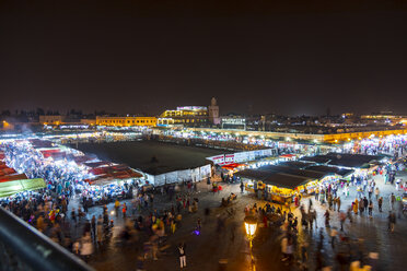 Morocco, Marrakesh, view over market at Djemaa el-Fna square in the evening - MMAF00485