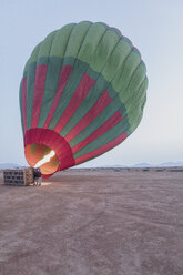 Morocco, Taza Province, air balloon being filled with heated air - MMAF00500