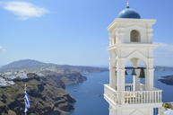 Traditional white bell tower of church on the island of Santorini, Greece. - MINF08645