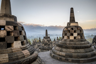 Borobudur temple, a 9th century Buddhist temple with terraces and stupa with latticed exterior, bell temples housing Buddha statues.  UNESCO world heritage site. - MINF08648