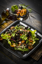 Leaf lettuce with steamed plums, champignons, almonds and cress - MAEF12709