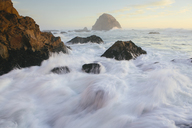 Seascape with breaking waves over rocks at dusk. - MINF08905