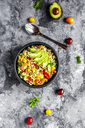 Bowl of bulgur salad with bell pepper, tomatoes, avocado, spring onion and parsley - SARF03918