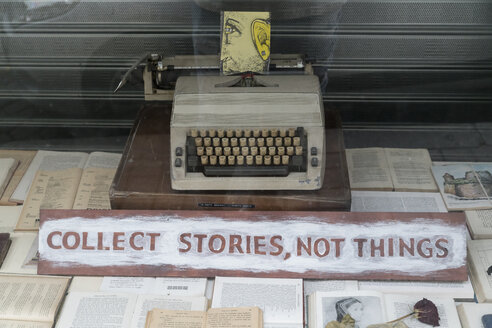 Portugal, Porto, view into window display with an old typewriter and the request 'Collect Stories not thing' - CHP00520