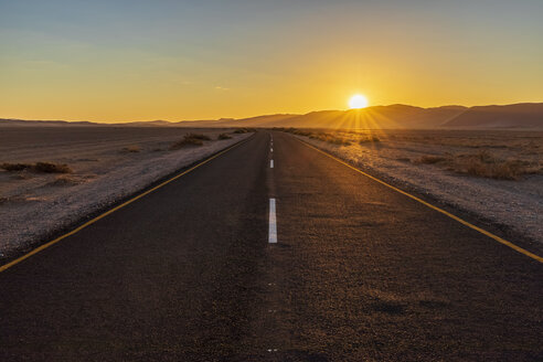 Africa, Namibia, Namib desert, Naukluft National Park, empty road at sunset - FOF10079