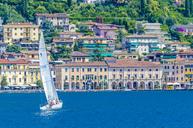 Italy, Lombardy, Salo, Lake Garda and sailing boat - MH00448