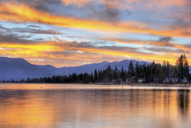 A brilliant fall sunrise is reflected in Lake Tahoe, California. - AURF01088