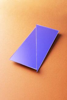 Broken rectangle shaped mirror on orange background - DRBF00072