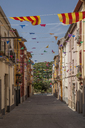 Spain, Catalonia, alley with Catalonian flags - JMF00423