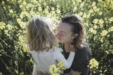 Mother and little daughter together in rape field - PSIF00015