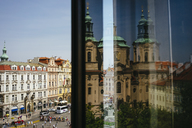 Czechia, Prague, view to Old Town Square and St. Nicholas Church reflecting on windowpane - GEMF02295