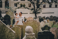 Czechia, Prague, father and baby girl visiting the old Jewish Graveyard - GEM02331