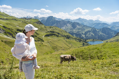 Germany, Bavaria, Oberstdorf, mother and little daughter on a hike in the mountains - DIGF04967