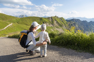 Germany, Bavaria, Oberstdorf, mother and little daughter on a hike in the mountains - DIGF04970