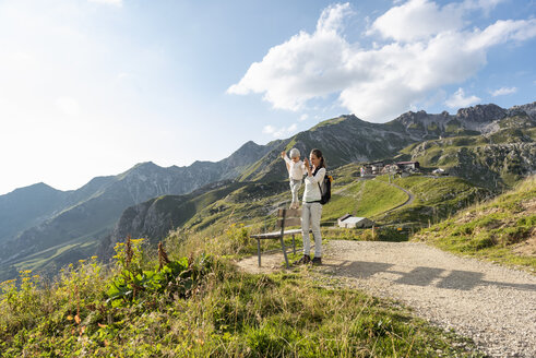 Germany, Bavaria, Oberstdorf, mother and little daughter on a hike in the mountains - DIGF04973