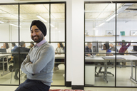 Portrait confident businessman in turban in office - CAIF21296