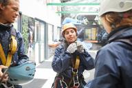 Friends preparing zip line equipment - CAIF21410