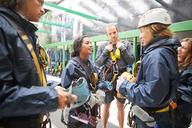 Friends preparing zip line equipment - CAIF21413