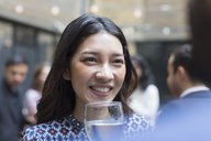 Smiling woman enjoying party - CAIF21452