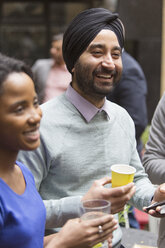 Smiling man in turban enjoying party - CAIF21470