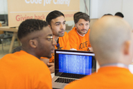Dedicated hackers coding for charity at hackathon - CAIF21497
