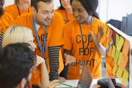 Hackers coding for charity at hackathon - CAIF21524
