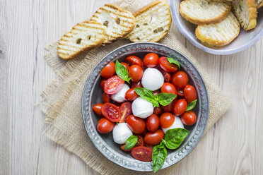 Italian food, caprese, mozzarella and tomatoes and basil - GIOF04247