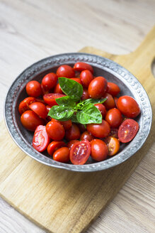 Tomatoes and basil in zinc bowl - GIOF04250