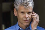 Portrait of mature businessman with grey hair on the phone - TCF05652