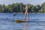 Young girl stand up paddle surfing - TCF05660