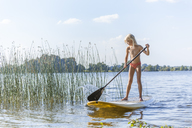Young girl stand up paddle surfing - TCF05663