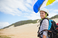 Portrait smiling, confident young female paraglider on beach - CAIF21707