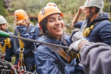 Portrait smiling woman zip lining - CAIF21740