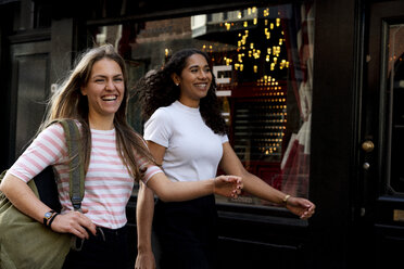 Two girlfriends on a city break, going on a shopping spree - HHLMF00362