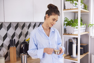 Young woman at home in kitchen, - ABIF00895
