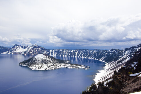 View of a snow covered island in Crater Lake, Oregon. - AURF01520