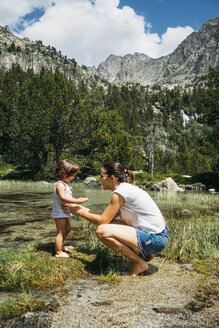 Spain, Mother and toddler exploring lakes in the Pyrenees - GEMF02339