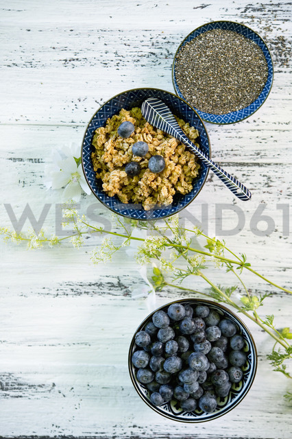 Bowls of granola, blueberries and black chia seeds - ASF06218